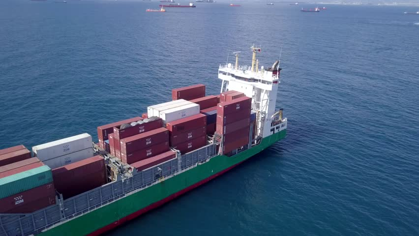 Mediterranean Sea - April 12, 2018: Aerial footage of a small container ship (Also known as Feeder) at sea.  #1009807754