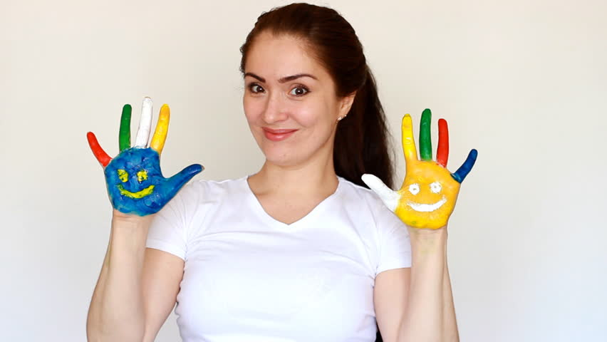 Painted hands multicolored with smiles. The concept of happiness, good mood, joy, creative, art and painting | Shutterstock HD Video #1009823894