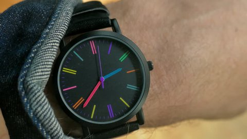 Checking the time on retro style wrist watch closeup