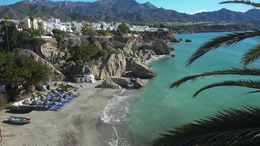 Nerja, Costa del Sol, Andalusia, Spain - April 03, 2018: Playa Calahonda beach below the town of Nerja with the Sierra de Tejeda, Almijara mountains in the background on the Costa del Sol in Spain. | Shutterstock HD Video #1009860944
