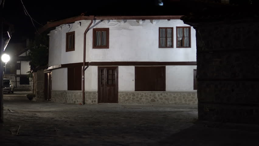 Establishment shot of Vintage dark alley and old traditional house in Bansko, Bulgaria. Bansko is most famous ski recreation centre in Bulgaria and Balcan peninsula