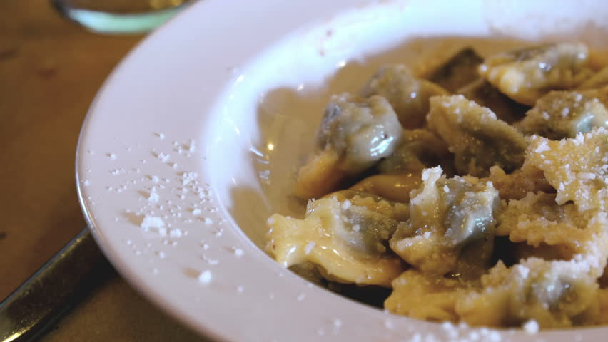 Agnolotti or Anolini with parmesan - agnolotti in the traditional italian cuisine is a variation of the most famous ravioli pasta from Emilia , Lombardy and Piedmont regions