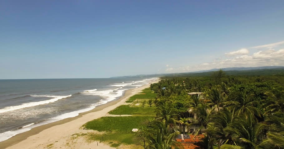 Aerial footage of a sunny day on the beach in El Salvador, Central America