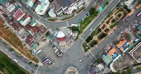 AERIAL 4K: drone flight over road junction,streets at Old Quarter and city of Dalat,Vietnam