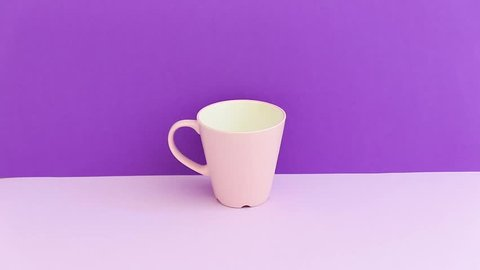 hand takes a pink mug with a drink. minimal