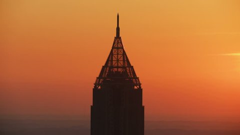 Aerial dawn sunrise view of the Art Deco style Bank of America Plaza and its unique pinnacle spire at the top Atlanta city Georgia America