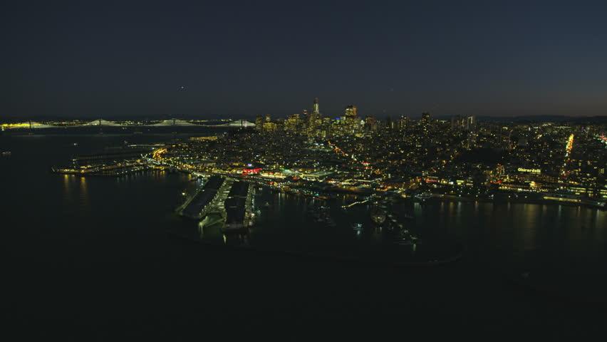 Aerial illuminated night cityscape view of Fishermans Wharf Pier 39 North Beach San Francisco Bay Oaklands Bay bridge California America