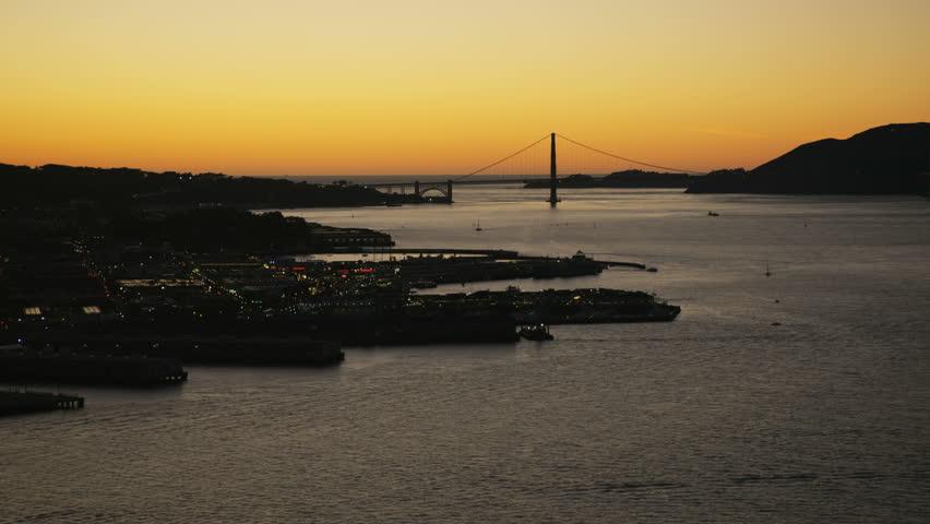 Aerial night illuminated night view of Fishermans Wharf Pier 39 North Beach San Francisco Bay Golden Gate Marin Headlands California America