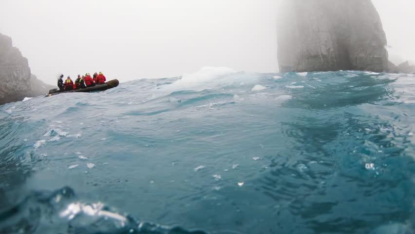 Antarctica Zodiac in Floating Ice Icebergs 50/50 underwater | Shutterstock HD Video #1009936874