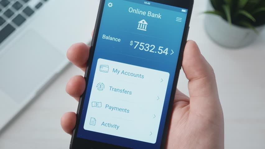Transferring money using banking app | Shutterstock HD Video #1009947164