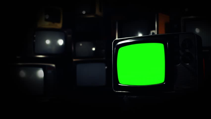 Vintage 80s Tv with Green Screen. Gold Rush Tone. Zoom In. Ready to replace green screen with any footage or picture you want.  | Shutterstock HD Video #1009948454