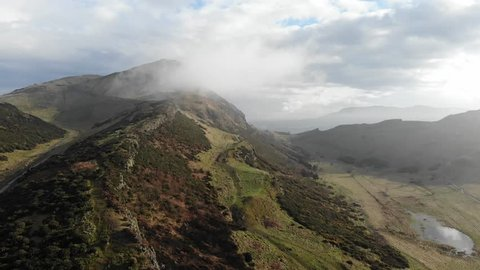 Aerial drone footage after rain at Arthur's seat with foggy and clouds, Edinburgh, Scotland, United Kingdom.