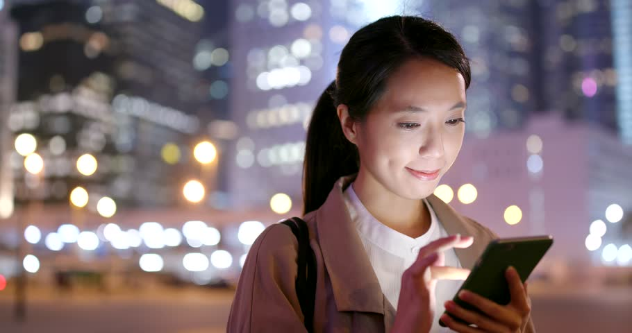 Young business woman work on mobile phone at night   Shutterstock HD Video #1009966484