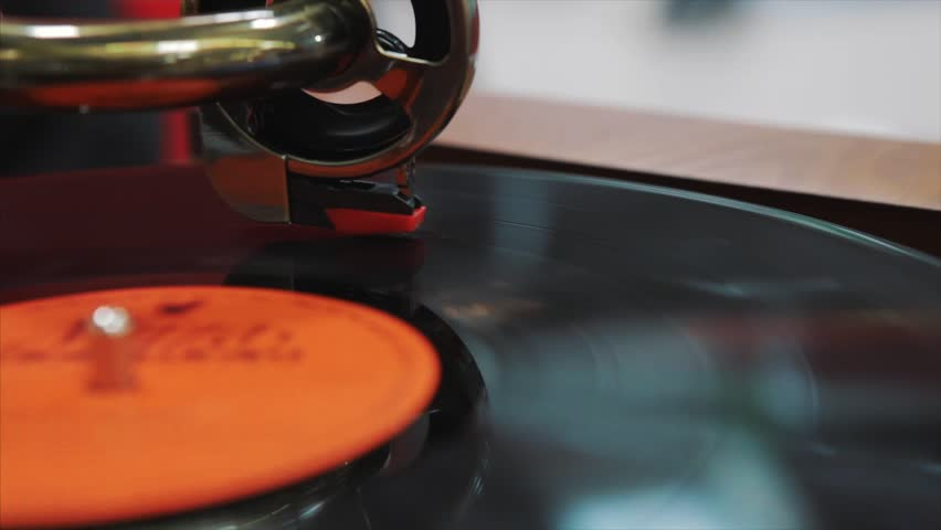 Vinyl gramophone. Cinemagraph Loop Vinyl Player View Top. Vinyl record on turntable. Top view close up. Loop-able Vintage Video of Old Gramophone, playing a music.