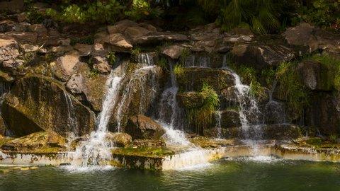 SANTA CRUZ, TENERIFE / SPAIN - FEBRUARY 27 2018: SMALL WATERFALL IN BOTANICAL GARDEN TIME LAPSE