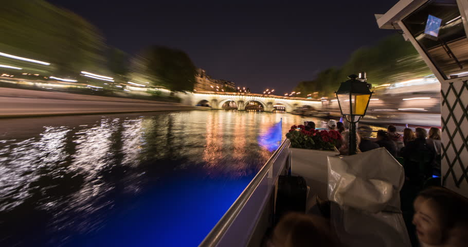 PARIS, FRANCE – SEPTEMBER 2016 : Moving timelapse / hyperlapse from a boat moving down river Seine at night with view of Notre Dame and central Paris | Shutterstock HD Video #1009990814