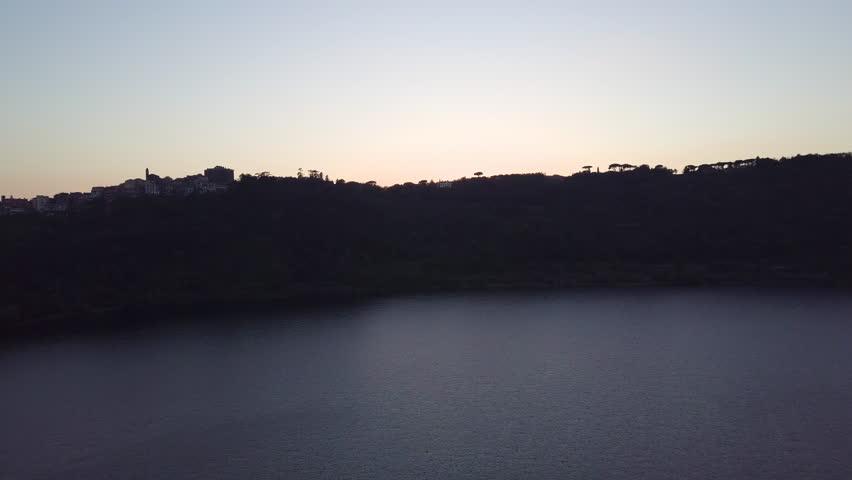 Drone over lago di Nemi, near Rome, Italy, at sunset.