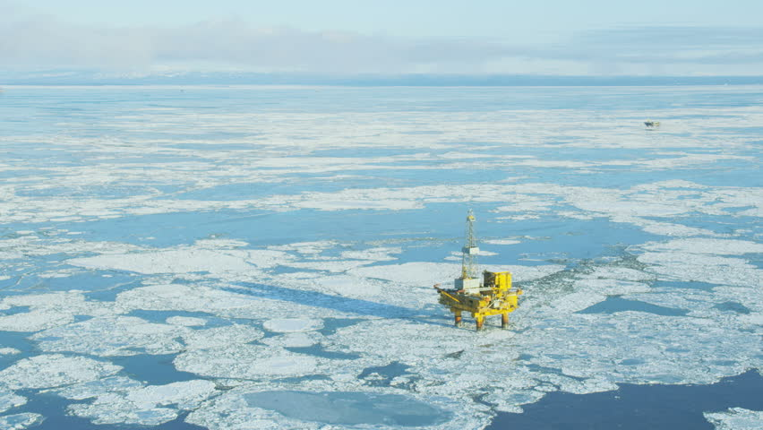 Aerial view of an offshore Industrial oil Rig in the Gulf of Alaska surrounded by a frozen sea Northern Pacific America