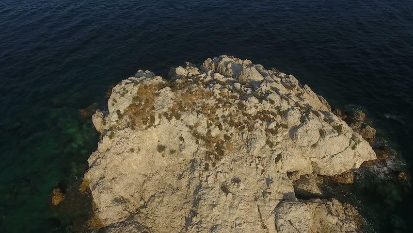 Above Islet . Flying above a small barron islet of the Aegean Sea in Greece