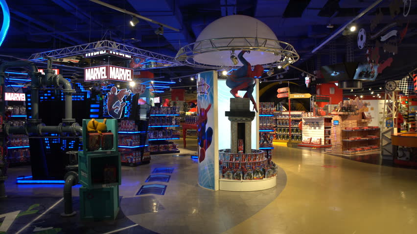 Moscow, Russia - March, 2018: 4K footage of interior of Marvel toys department in Hamleys store. Marvel Comics Group is a publisher of American comic books and related media