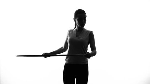 Serious athletic girl sport twisting hula hoop, exercising to lose weight, sport