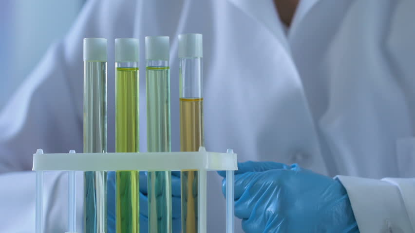 Laboratory worker numbering test tubes with samples, scientific experiment | Shutterstock HD Video #1010106284