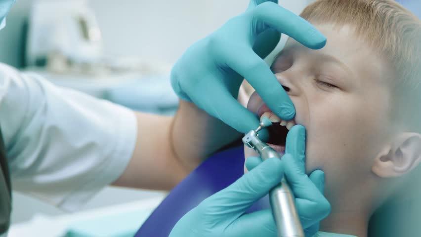 Kid in a dental clinic | Shutterstock HD Video #1010116484