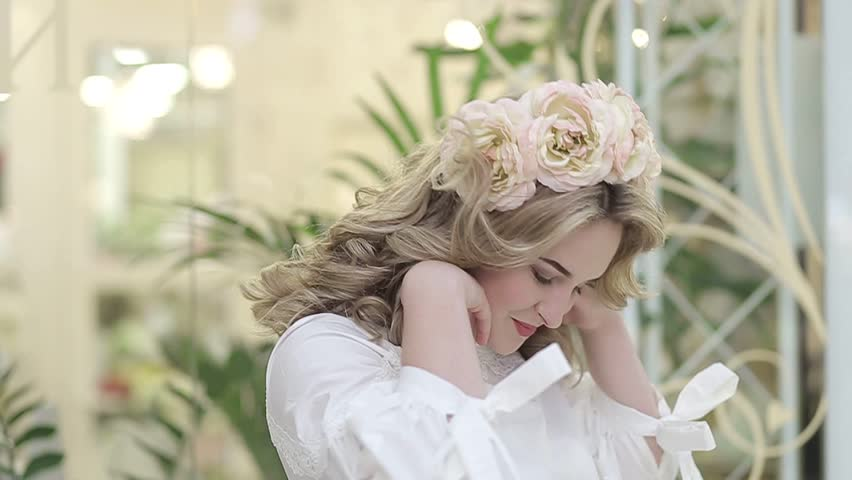The girl advertises the flower shop   Shutterstock HD Video #1010117834