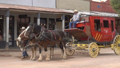 TOMBSTONE, ARIZONA/USA - NOVEMBER 07, 2017: Stagecoach in street. Tombstone is a historic city founded in 1879, one of the last boomtowns in the American frontier.