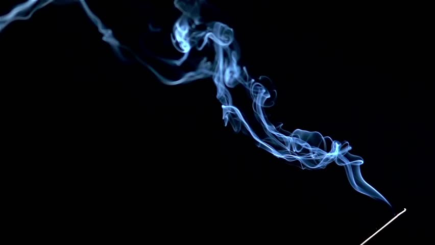 Incense stick are burning and smoke on black background,Smoke from incense. Slow motion