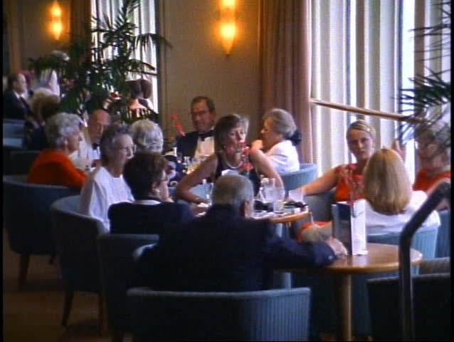 QUEEN ELIZABETH 2, 1999, QE2, Chart Room bar with crowd having drinks | Shutterstock HD Video #1010162114