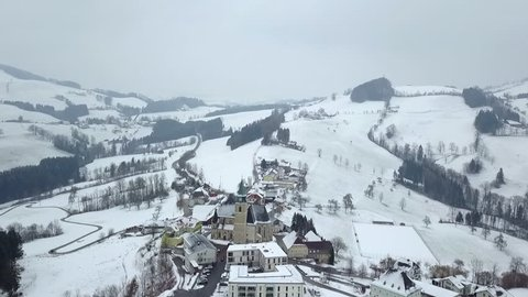 AERIAL WS POV Chapel in winter / Neustift, Upper Austria, Austria