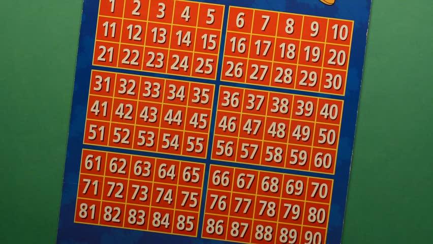 bingo game - put the numbers - green table - closeup