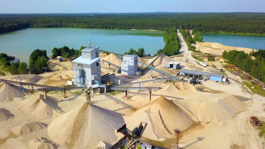 Aerial view of sandpit and factory plant producing sand materials for construction industry. Drone view of large manufacturing plant in landscape. Halamky near Trebon, Czech republic, European union.