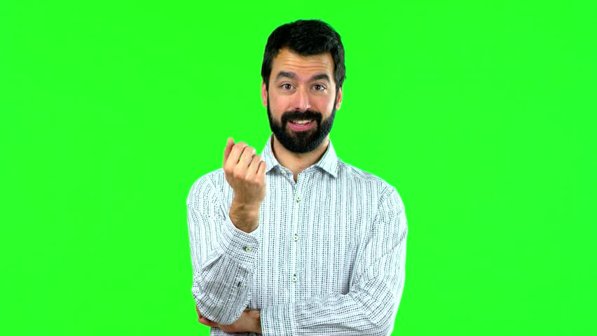 Man doing coming gesture on green screen chroma key