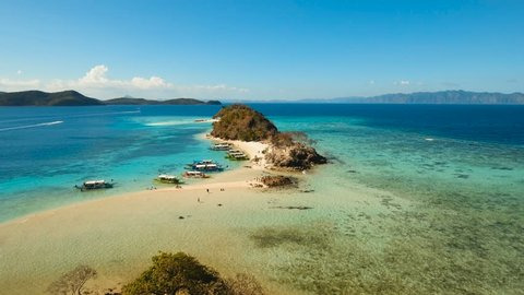 Aerial view of tropical beach with beach,resort, hotels. Philippines. Beautiful tropical island with sand beach, palm trees. Tropical landscape: beach with palm trees. Seascape: Ocean, sea. 4K video