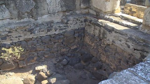 Dark stones in the foundation of the Synagogue in Capharnaum mark the foundation of the old Synagogue where most likely Jesus preached according to the Gospel of Luke