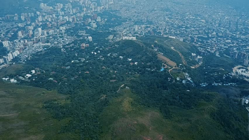 Cali, Colombia Tilt Revel from high above Cristo Rey monument,