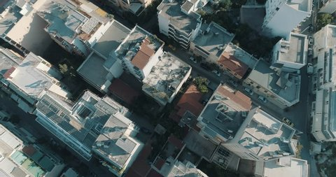 4K Athens aerial downtown buildings rooftops.Aerial views of tight concrete buildings and vertical views of, typical downtown neighbourhoods streets and rooftops near the center of Athens.