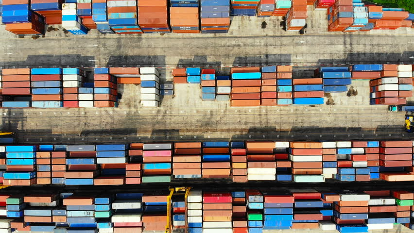 Commercial port with Logistics and transportation of Container Cargo ship and Cargo import/export and business logistics,Aerial view footage  | Shutterstock HD Video #1010409914