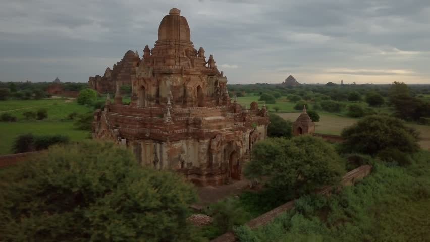 Drone shot aerial view of Bagan archeological zone with ancient temples buddhist religion in greenery landscape shot in 4K resolution October nature travel destinations concept