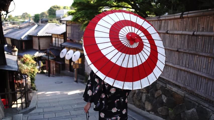 Woman wearing a kimono walks in Kyoto Japan | Shutterstock HD Video #1010455994