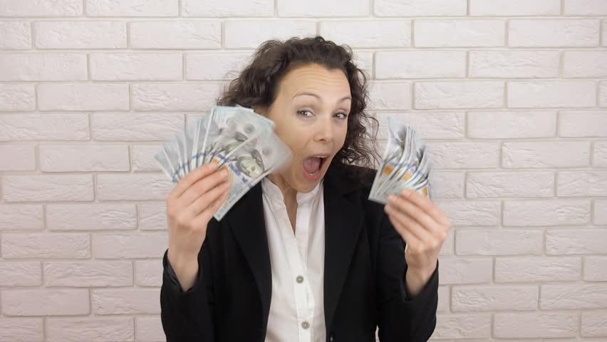 A business woman enjoys profit. Tosses money. | Shutterstock HD Video #1010489834