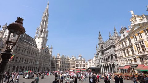 Brussels, Belgium - 20.04.2018: Time lapse footage of Tourist at  Grand place square Town hall in Brussels, Belgium. Tourist crowd people walk