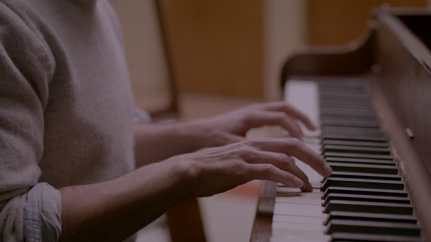 Close up of musician playing the piano HD stock video. Alexa camera