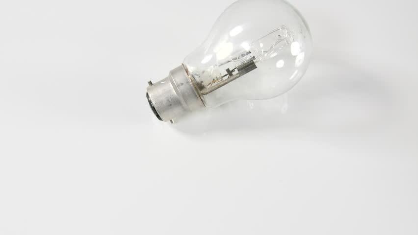 4k dolly over lamp Light bulb moving against white background | Shutterstock HD Video #1010522054