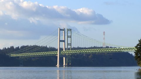 The Tacoma Narrows toll bridge is actually a pair of suspension bridges that spans the Tacoma Narrows strait of Puget Sound. Westbound traffic does not pay a toll, while eastbound traffic does.