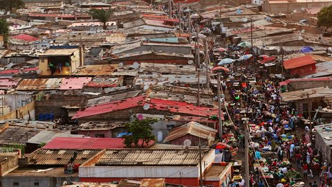 Long shot of the Lixeira (landfill) slum market at sunset in Luanda, Angola.