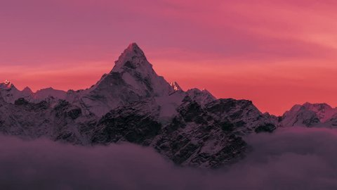 Greatness of nature cocncept: grandiose view of Ama Dablam peak (6812 m) at sunrise. Nepal, Himalayan mountains. Time lapse zoom out.