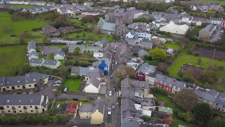 4k Aerial Drone Shot of Small Town Ireland with Lush Green Grass and Fields Nearby. Green City with Colorful Buildings | Shutterstock HD Video #1010581784